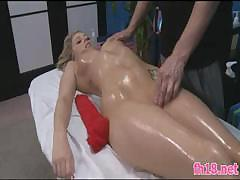 Horny massage guy rubs cute girl's oiled pussy and makes her cum