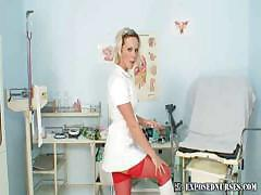 Naughty nurse masturbation at gyno clinic, fingering her pussy and playing with speculums