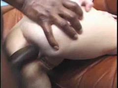 Big tit milf takes a black cock up her arse