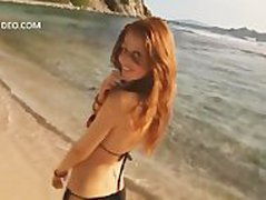 Cintia Dicker hald naked on the beach