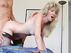 Blonde Mature takes cumshot with gum in your mouth