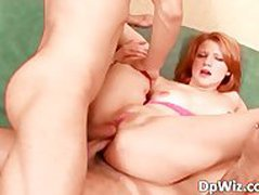 Sexy redhead gets double cock in the