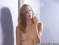 Petite sexy blonde babe smoking with no clothes