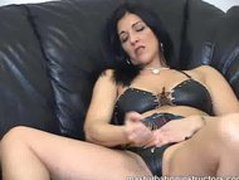 Masturbation instructor demos jerk off on her pussy