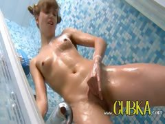 Sweet coed Katie getting wet in a shower