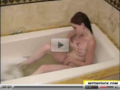 Petite girl masturbating in the bath tub