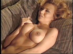 Beautiful big breasted blonde gets fucked on couch