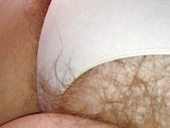 long pubic hair bulging from her white pantys,