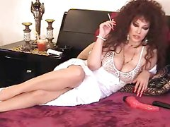 Hot Mature Brunette Solo Smoking and Lounging On Bed