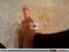 Crossdress foot job on 9 inch dildo
