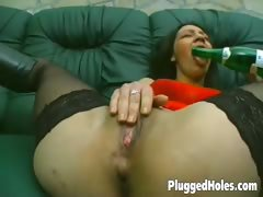 Sexy girl sticks a bottle in her pussy