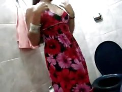 Indian showing off in bathroom