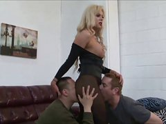 Blonde Shemale Dominates Two Guys