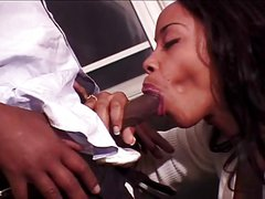 Black babe hungrily sucks black uncut cock.