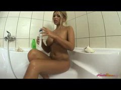 Amazing big tit blonde gives a soapy show