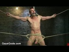 Extended by ropes gay gets whipped in standing position