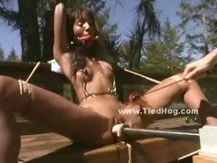 Black beauty used like a slave outdoor in brutal bdsm sex tied on a bench and tortured