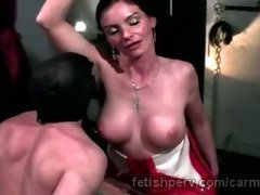 Big boobed brunette mistress in latex punishes hung sex slave
