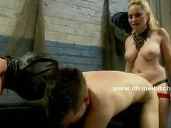 Mistress fucks two slaves in the ass and makes them eat out her cunt while flogging their asses