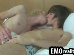 Hot young emo teens lay in bed together in their underwear