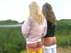 Two 20yo chicks naked outside by lake