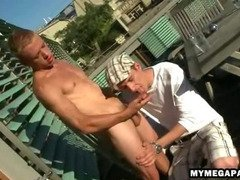 Stud sucks a cock on the balcony before anal sex
