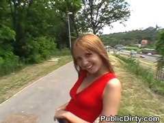 Redheaded European Flashing Her Tits In Public