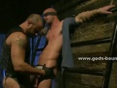 Gagged man has his cock sucked on a metal bed against his wish by a dominating gay guy