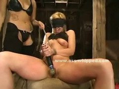 Blonde teen has her nipples clamped by an Asian cowgirl who does a gret job in riding her pussy