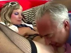 Older guy fucks young blonde in stockings