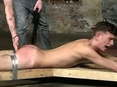 Restrained hunk sucks cock and gets his ass fucked