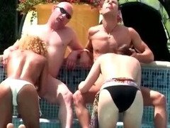 Hot and sunny group sex by the pool
