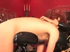 Mistress whipping her subject for his punishment