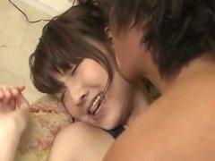 After having her body suit cut off of her Shiori Uta finds her mouth filled with a hard rigid cock