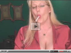 Sexy Mature Blonde shows her stuff while smoking