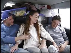 Brunette Violenza does two guys in the back of a van