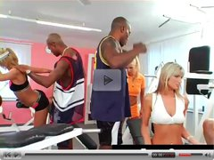 Blonde girls and black guys in a gym