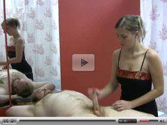 Masseuse is focused in pleasuring client