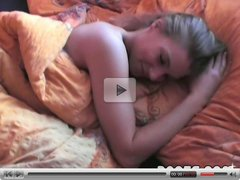 Splendid blonde with a big dildo in her bed