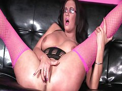 British slut Emma plays with herself in fishnet stockings