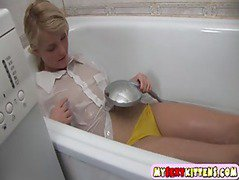 Young blondie in a bath tub