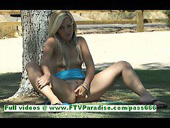 Hot blonde woman with natural tits fingering pussy in the great outdoor