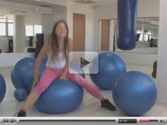Teenager with exercise balls