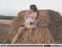 Naked teen on a pile of hay