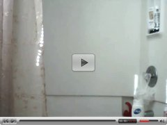 Chick in shower with Dildo