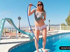 Ivana teasing her hot body with a hose by the pool