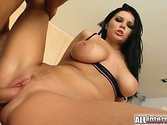 A super hot big titted brunette pleasures two guys. She gets her pink pussy filled with two big load of man juice. The cum oozes out perfectly
