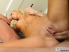This amazing blonde has a smoking hot body and a pierced clit. She gets her pussy and ass banged hard in a hot double penetration. Both guys cum inside her ass