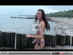 german brunette masturbates at public beach