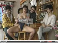 Horny Milf Lets The Guys In The Bar Take Turns On Her Cunt